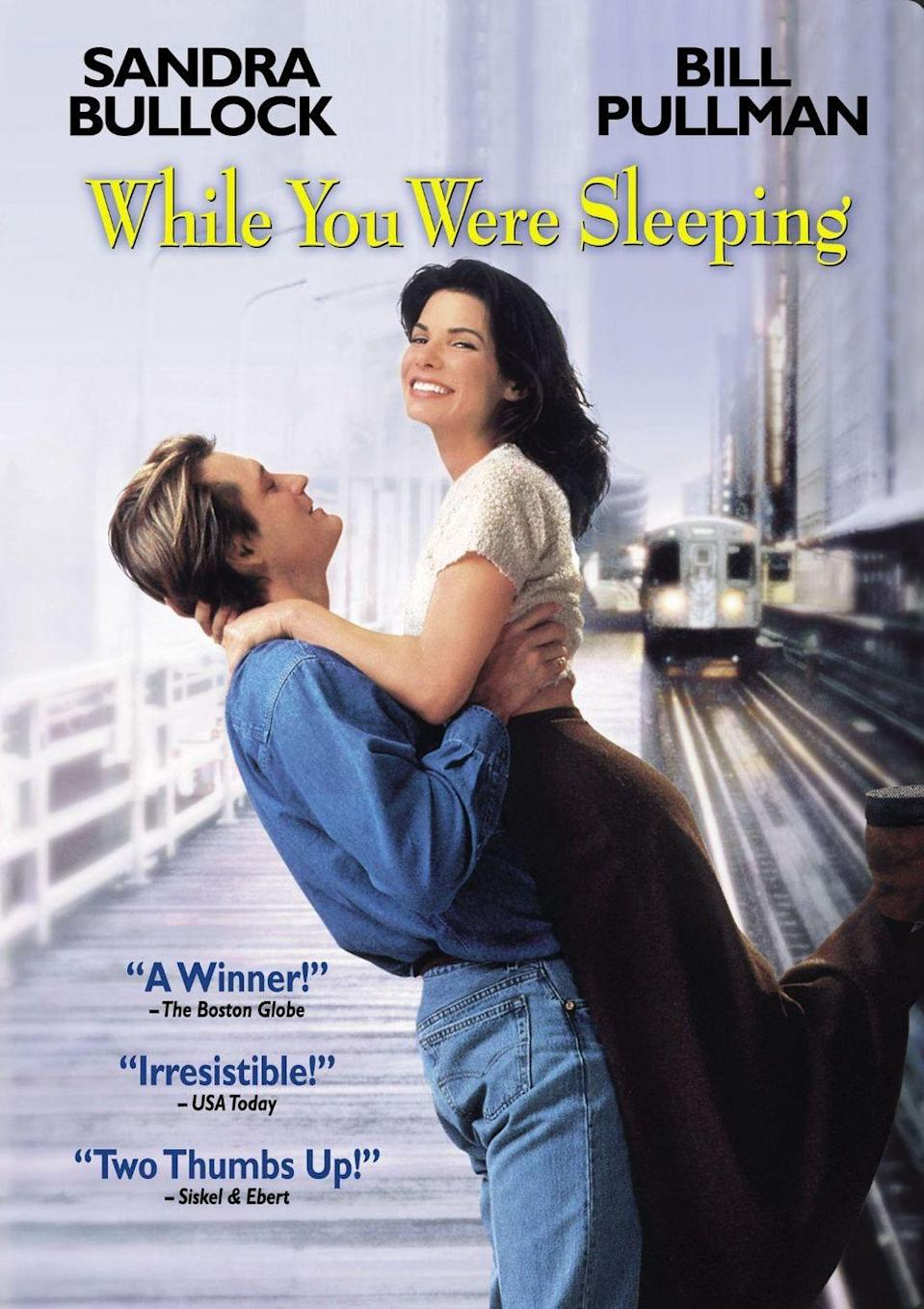 """<p>It's not X-mas without a classic holiday rom-com! Sandra Bullock charms in this one about a subway worker who saves a man's life on Christmas Day, only to eventually fall in love with his brother.</p><p><a class=""""link rapid-noclick-resp"""" href=""""https://www.amazon.com/While-Were-Sleeping-Bill-Pullman/dp/B003QS64XU?tag=syn-yahoo-20&ascsubtag=%5Bartid%7C10055.g.1315%5Bsrc%7Cyahoo-us"""" rel=""""nofollow noopener"""" target=""""_blank"""" data-ylk=""""slk:WATCH NOW"""">WATCH NOW</a></p>"""