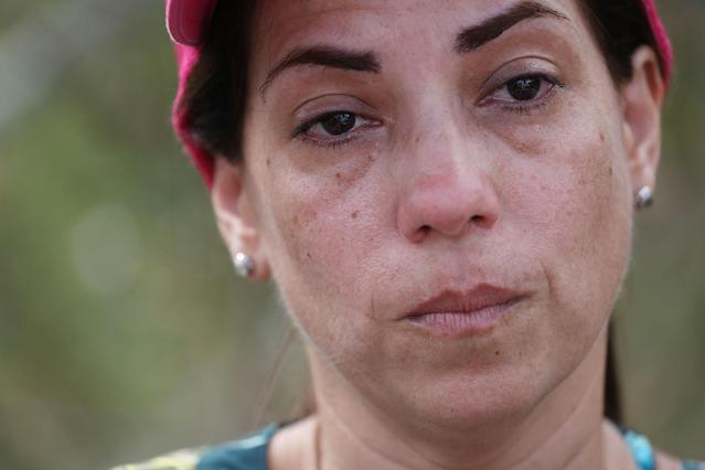 <p>Lizzy Alicea becomes emotional as she speaks about the lack of aide that is reaching her mother's home town September 24, 2017 in Hayales de Coamo, Puerto Rico. Puerto Rico experienced widespread damage after Hurricane Maria, a category 4 hurricane, passed through. (Photo: Joe Raedle/Getty Images) </p>