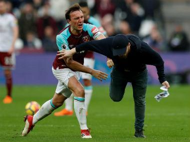 West Ham on Thursday issued lifetime bans to five fans who invaded the pitch during their Premier League match against Burnley earlier this month.