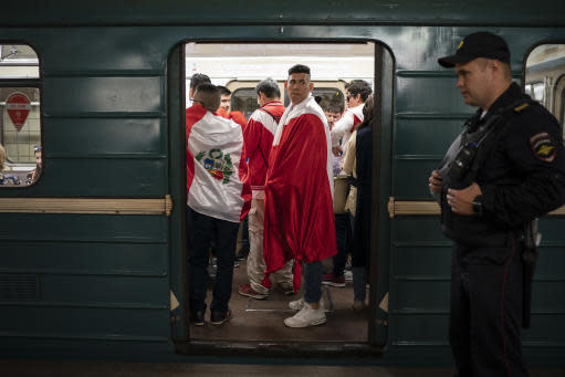 In this June 14, 2018 photo soccer fans ride in the metro near the Luzhniki stadium before the group A match between Russia and Saudi Arabia which opens the 2018 soccer World Cup in Moscow, Russia. (AP Photo/Felipe Dana)