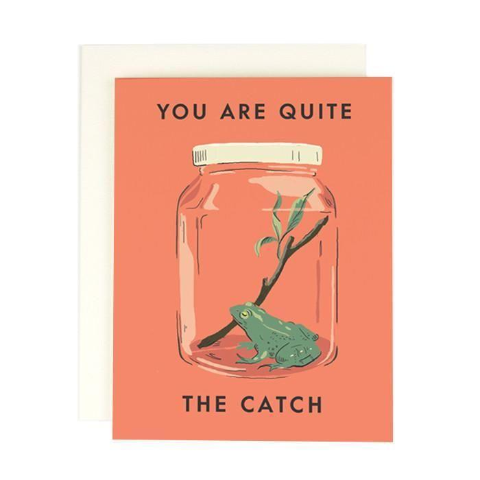"""<p>amyheitman.com</p><p><strong>$5.00</strong></p><p><a href=""""https://amyheitman.com/collections/greeting-cards/products/quite-the-catch"""" rel=""""nofollow noopener"""" target=""""_blank"""" data-ylk=""""slk:Shop Now"""" class=""""link rapid-noclick-resp"""">Shop Now</a></p><p>""""This card reminds me of my grandmother and her love for collecting frog tchotchkes—so I'll be dropping this cute card in my mailbox for her on Valentine's Day. She'll toadally love it!""""<br></p><p>Julia Ludlam, Associate Art Director</p>"""