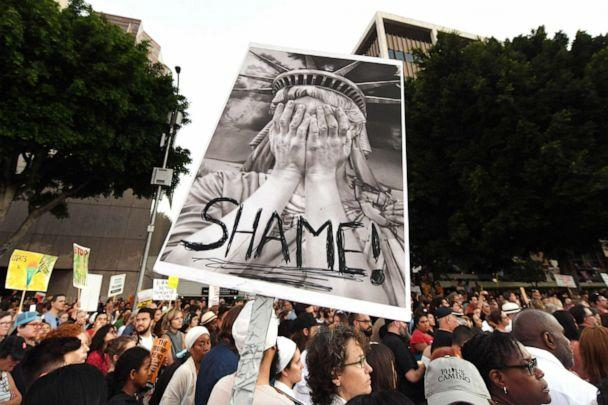PHOTO: People protest against the upcoming ICE raids and detentions of refugee asylum seekers at a vigil outside the main ICE detention center (background) in downtown Los Angeles, July 12, 2019. (Mark Ralston/AFP/Getty Images)