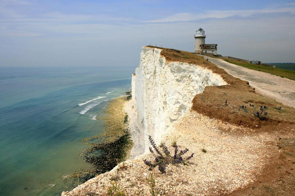 """<p>After almost two centuries of petitioning for a lighthouse along this particularly perilous stretch of coastline, <a href=""""https://www.belletout.co.uk/"""" rel=""""nofollow noopener"""" target=""""_blank"""" data-ylk=""""slk:Belle Tout"""" class=""""link rapid-noclick-resp"""">Belle Tout</a> was constructed in 1832. By 1902, however, it had been decommissioned, and a new lighthouse was built at the base of the cliffs. Between 1902 and 2008, the lighthouse passed into different ownerships, used as target shelling practice during WWII by Canadian troops, and moved back 17 metres due to the impending threat of erosion. </p><p>The product of careful renovations, Belle Tout opened in 2010 as a bed and breakfast. Its rooms are playfully themed according to the building's nautical heritage: The Captain's Cabin, Old England and Keeper's Loft.</p><p>The <a href=""""https://www.vintageinn.co.uk/restaurants/south-east/thebeachyheadeastbourne"""" rel=""""nofollow noopener"""" target=""""_blank"""" data-ylk=""""slk:Beachy Head Pub"""" class=""""link rapid-noclick-resp"""">Beachy Head Pub</a> and the <a href=""""http://www.ploughandharrowlitlington.co.uk/"""" rel=""""nofollow noopener"""" target=""""_blank"""" data-ylk=""""slk:Plough and Harrow"""" class=""""link rapid-noclick-resp"""">Plough and Harrow</a> are two excellent local pubs at which to while away your afternoons or to soak up the evening's excesses. Visitors tend to explore the area either on foot (try the <a href=""""https://www.beachyhead.org.uk/app/uploads/2017/07/Beachy_Head_Walk.pdf"""" rel=""""nofollow noopener"""" target=""""_blank"""" data-ylk=""""slk:Beachy Head walk"""" class=""""link rapid-noclick-resp"""">Beachy Head walk</a>) or by bike (visit the nearby <a href=""""https://www.app-bike.co.uk/"""" rel=""""nofollow noopener"""" target=""""_blank"""" data-ylk=""""slk:bike rental and sharing station"""" class=""""link rapid-noclick-resp"""">bike rental and sharing station</a>).</p>"""