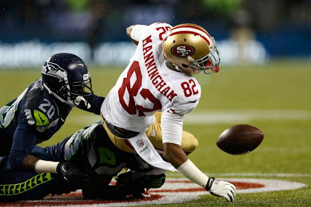SEATTLE, WA - DECEMBER 23: Mario Manningham #82 of the San Francisco 49ers fumbles the ball in the third quarter against the Leroy Hill #56 and Jeremy Lane #20 (L) of the Seattle Seahawks at Qwest Field on December 23, 2012 in Seattle, Washington. (Photo by Otto Greule Jr/Getty Images)