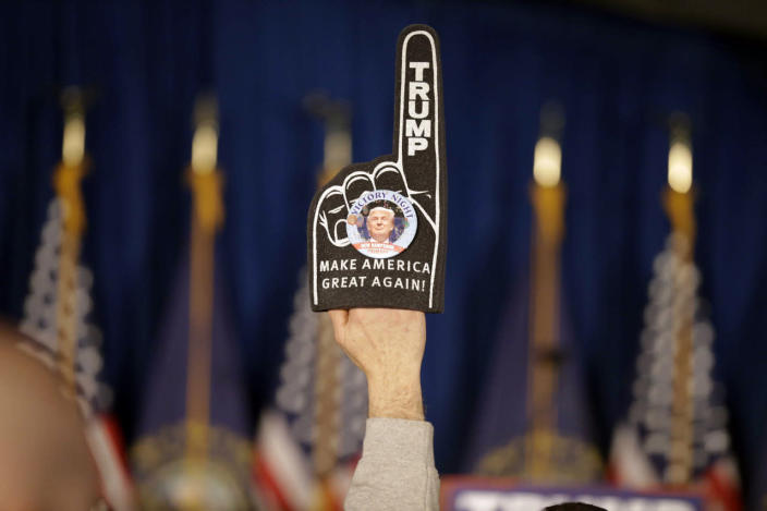 <p>A supporter holds a foam finger sign promoting Republican presidential candidate Donald Trump before he speaks at a primary night rally on Feb. 9, 2016, in Manchester, N.H. (David Goldman/AP)</p>
