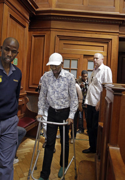 Xolile Mngeni with his walking frame as he approaches the dock, in a courtroom, in Cape Town, South Africa, Monday, Nov. 19, 2012, as he awaits the court's verdict. Mngeni,was arrested for the killing of 28-year-old Anni Dewani. Prosecutors say Mngeni was hired by Dewani's British husband to carry out the November 2010 killing, which was made to look like a car hijacking. (AP Photo/Schalk van Zuydam)