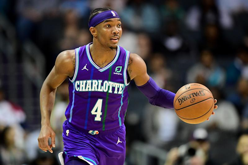 CHARLOTTE, NORTH CAROLINA - DECEMBER 27: Devonte' Graham #4 of the Charlotte Hornets with the ball during the fourth quarter during their game against the Oklahoma City Thunder at the Spectrum Center on December 27, 2019 in Charlotte, North Carolina. NOTE TO USER: User expressly acknowledges and agrees that, by downloading and/or using this photograph, user is consenting to the terms and conditions of the Getty Images License Agreement. (Photo by Jacob Kupferman/Getty Images)