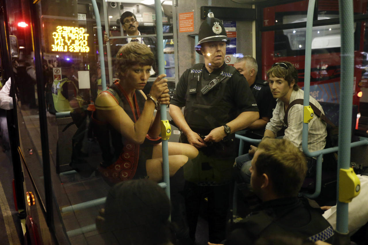 Arrested cyclists are loaded on to a bus after a protest outside the Olympic Park during the 2012 Summer Olympics Opening Ceremony, Friday, July 27, 2012, in London. (AP Photo/Matt Rourke)
