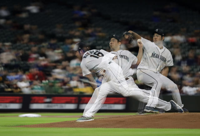 In this multiple-exposure photo, Seattle Mariners starting pitcher Yusei Kikuchi throws against the Oakland Athletics during the sixth inning of a baseball game, Monday, May 13, 2019, in Seattle. (AP Photo/Ted S. Warren)
