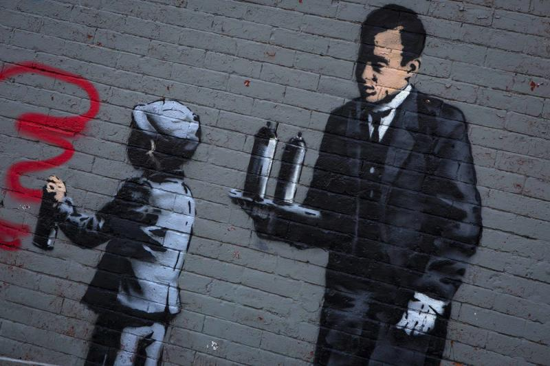 An installation by British graffiti artist Banksy is seen in the Bronx section of New York October 21, 2013. Known for his anti-authoritarian black-and-white stenciled images, which have sold at auction for upwards of $2 million, Banksy is treating New Yorkers to a daily dose of spray-painted art - while eluding the police and incurring the wrath of New York Mayor Michael Bloomberg. REUTERS/Eric Thayer (UNITED STATES - Tags: SOCIETY)