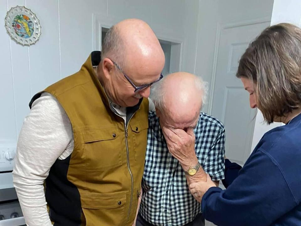 Ninety-year-old Freeman Pennell of Lark Harbour, N.L., couldn't hold back tears as he met his nephew, Rick Betts, for the first time. Betts is the biological son of Pennell's sister, Hazel. (Submitted by Sandee Betts - image credit)
