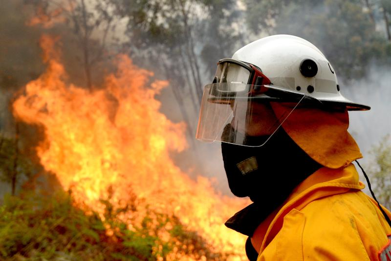 Firefighters backburn along Putty Road in Colo Heights in Sydney on Saturday. Source: AAP