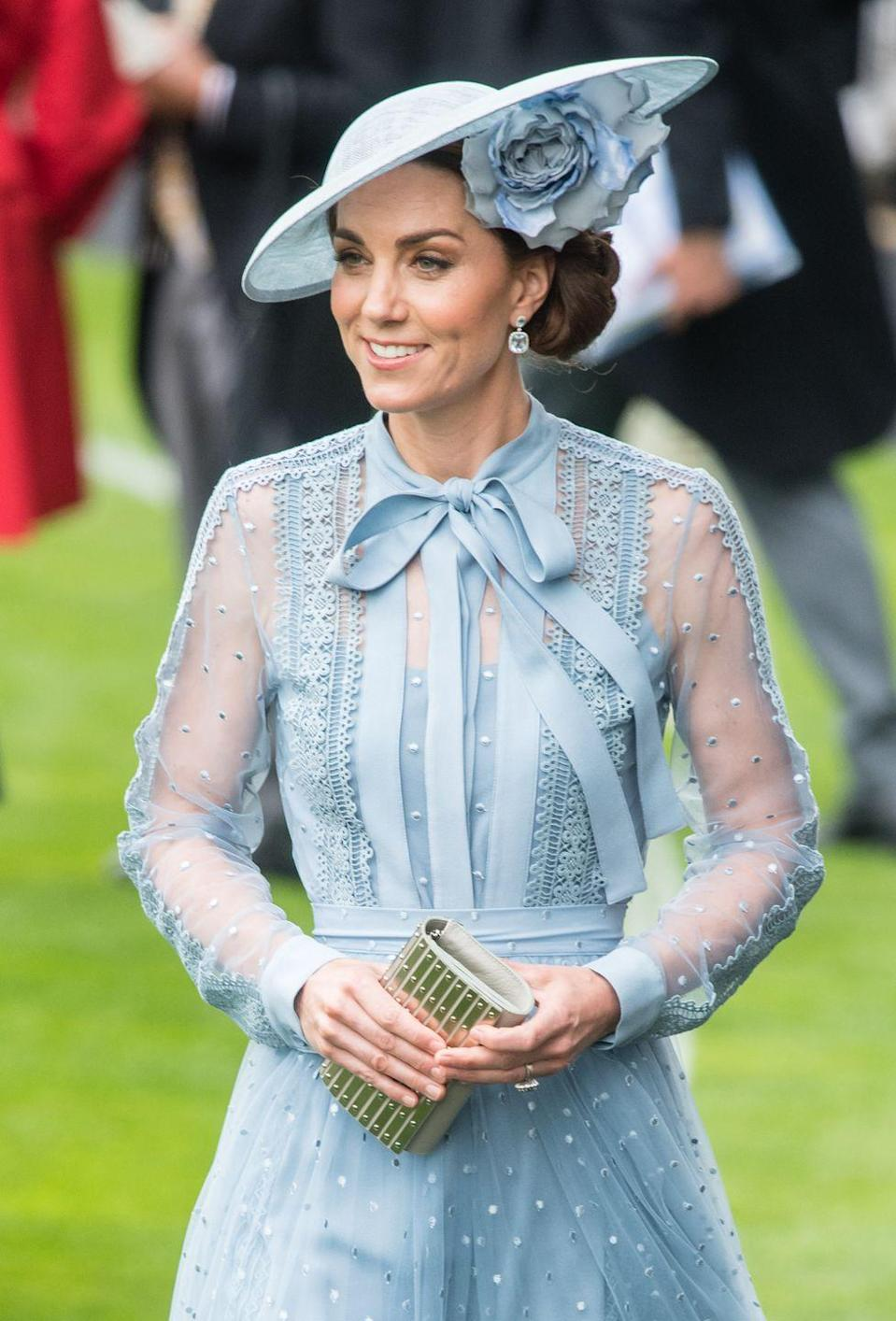 "<p>Kate showed the Royal Ascot crowd how it's done when she arrived at the racecourse sporting <a href=""https://www.townandcountrymag.com/style/fashion-trends/a28072096/kate-middleton-elie-saab-blue-dress-royal-ascot-day-1-2019/"" rel=""nofollow noopener"" target=""_blank"" data-ylk=""slk:a statement hat by Philip Treacy"" class=""link rapid-noclick-resp"">a statement hat by Philip Treacy</a>, which featured a stunning floral adornment.<br></p>"