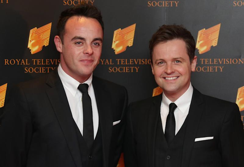 British TV presenters Ant, left and Dec, or Anthony McPartlin and Declan Donnelly, share a joke as they arrive for the Royal Television Society Programme Awards, at Grosvenor House Hotel in central London, Tuesday, March 18, 2014. (Photo by Joel Ryan/Invision/AP Images)