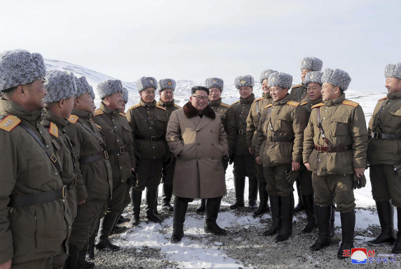 "This undated photo provided on Wednesday, Dec. 4, 2019, by the North Korean government shows North Korean leader Kim Jong Un, center, speaks to lieutenants during his visit to Mount Paektu, North Korea. North Korea says leader Kim has taken a second ride on a white horse to a sacred mountain in less than two months. Independent journalists were not given access to cover the event depicted in this image distributed by the North Korean government. The content of this image is as provided and cannot be independently verified. Korean language watermark on image as provided by source reads: ""KCNA"" which is the abbreviation for Korean Central News Agency. (Korean Central News Agency/Korea News Service via AP)"