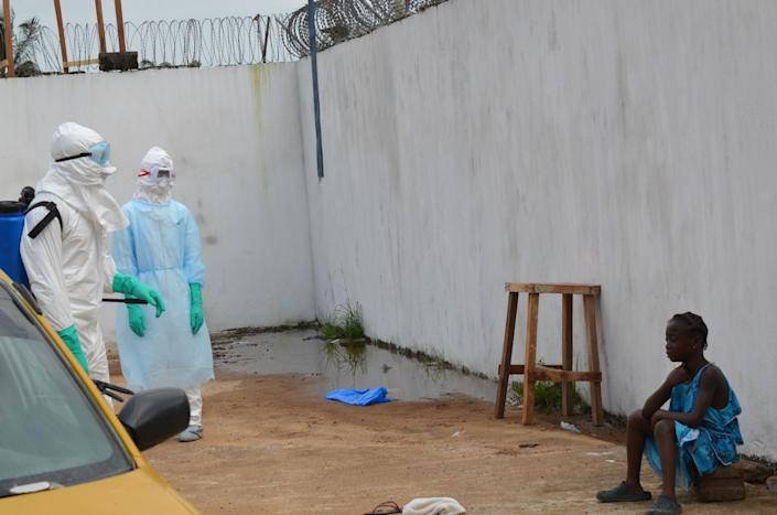 """A girl cries outside the """"Island Clinic"""", a new Ebola treatment centre that opened in Monrovia after the death of her father and her mother on September 23, 2014 (AFP Photo/Zoom Dosso )"""