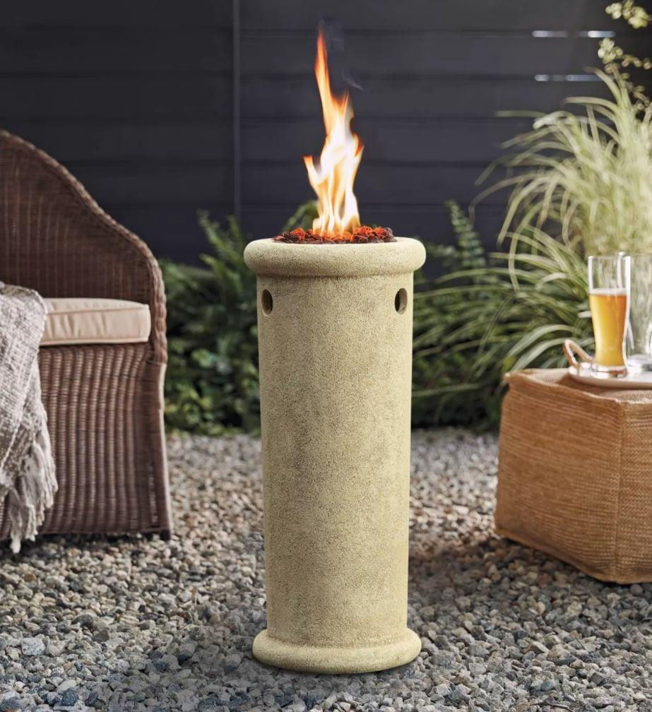 <p>This <span>Threshold Classic Round Outdoor LP Fire Column</span> ($119) will make for warm nights around the fire.</p>