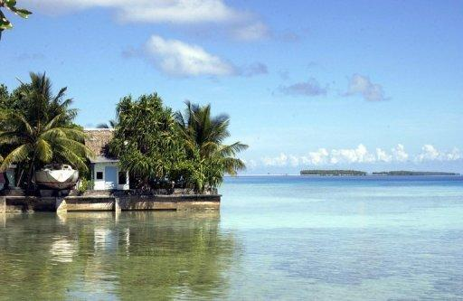 A concrete wall lining Atafu lagoon to hold back rising sea levels in the New Zealand dependency of Tokelau. Tiny Pacific nations which are most at threat from rising seas have vowed to dump diesel and other dirty expensive fuels blamed for causing global warming and replace them with clean sources
