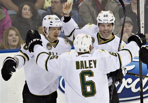 Dallas Stars' Philip Larsen, left, Trevor Daley, center, and Jaromir Jagr celebrate Jagr's game-winning goal against the Edmonton Oilers in an overtime NHL hockey game, Wednesday, Feb. 6, 2013, in Edmonton, Alberta. (AP Photo/The Canadian Press, Jason Franson)