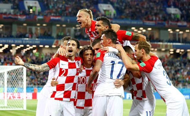 Soccer Football - World Cup - Group D - Croatia vs Nigeria - Kaliningrad Stadium, Kaliningrad, Russia - June 16, 2018 Croatia's Luka Modric celebrates with team mates after scoring their second goal REUTERS/Fabrizio Bensch TPX IMAGES OF THE DAY