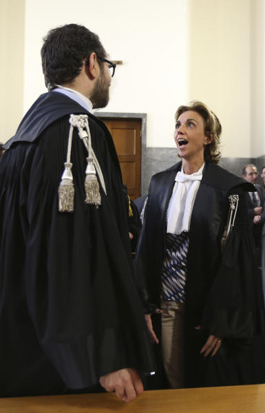 Prosecutors Laura Pedio and Gaetano Ruta look each others prior to the sentence at the Milan's court Italy, Wednesday, June 19, 2013. A Milan court convicted fashion designers Domenico Dolce and Stefano Gabbana of tax evasion. The pair were found guilty Wednesday of failing to declare euros 1 billion ($1.3 billion) in income to authorities. The court sentenced them both to one year and eight months in jail. Prosecutors argued that the pair had evaded taxes on income of 416 million euros each and 200 million euros through a Luxembourg-based company. The statute of limitations ran out on a charge of misrepresenting income. (AP Photo/Luca Bruno)