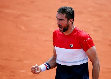 FILE PHOTO: Tennis - French Open - Roland Garros, Paris, France - May 31, 2018 Croatia's Marin Cilic celebrates during his second round match against Poland's Hubert Hurkacz. REUTERS/Charles Platiau
