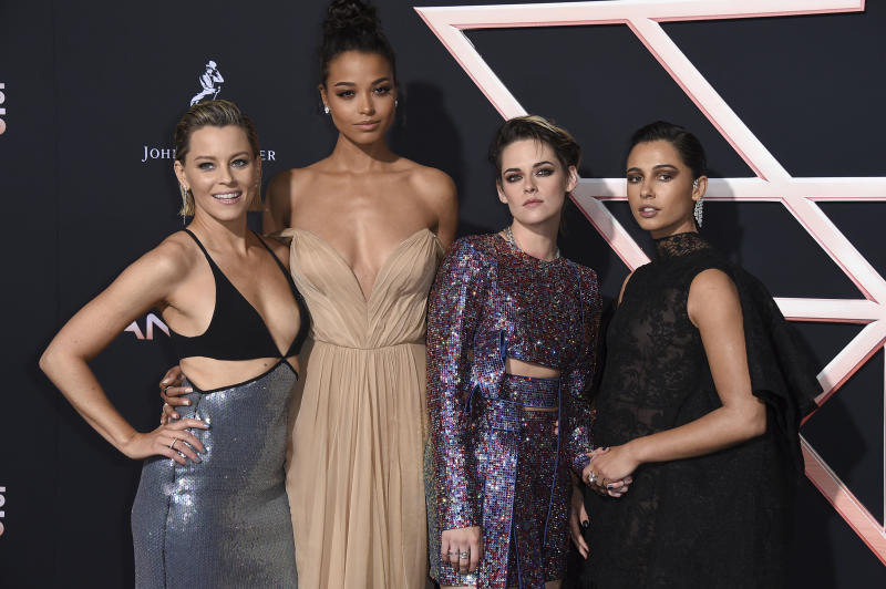 """Director/writer/actress Elizabeth Banks, from left, and actresses Ella Balinska, Kristen Stewart and Naomi Scott arrive at the Los Angeles premiere of """"Charlie's Angels"""" at the Regency Theater Westwood on Monday, Nov. 11, 2019. (Photo by Jordan Strauss/Invision/AP)"""