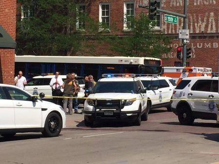 Police vehicles sit at 15th and Wynkoop, after an active shooter was reported and police secured the scene, in Denver, Colorado