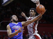 Rutgers' Greg Lewis (35) tries to block a shot by St. Francis Brooklyn's Jalen Cannon (5) during the first half of an NCAA college basketball game Sunday, Nov. 23, 2014, in Piscataway, N.J. (AP Photo/Mel Evans)