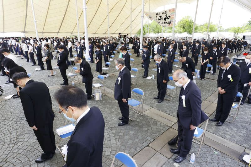 People practice social distancing as they offer a silent prayers for the victims of the 1945 atomic bombing, during a ceremony commemorating the 75th anniversary of the bombing in Nagasaki
