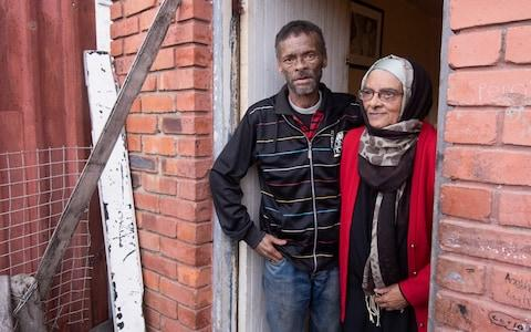 Shaida Adams, 73, and her son Turner, 54, were forcibly moved to the Lavender Hill township in the Apartheid era. Turner went on to become a feared gangster - Credit: Brenton Geach/The Telegraph