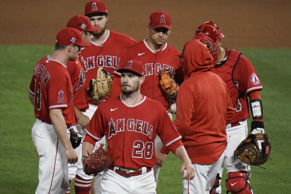Los Angeles Angels starting pitcher Andrew Heaney, center, leaves the mound and the baseball game during the seventh inning against the Tampa Bay Rays, Thursday, May 6, 2021, in Anaheim, Calif. (AP Photo/Jae C. Hong)