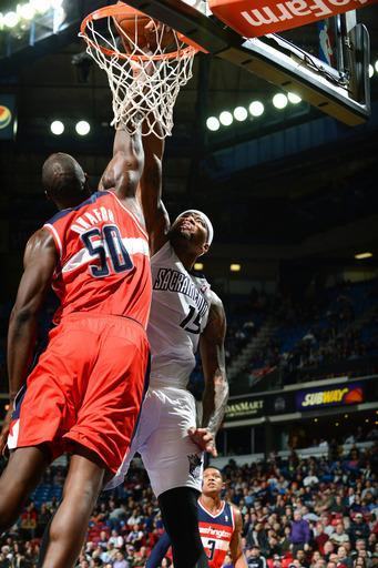 SACRAMENTO, CA - JANUARY 16: DeMarcus Cousins #15 of the Sacramento Kings dunks the ball against Emeka Okafor #50 of the Washington WIzards on January 16, 2013 at Sleep Train Arena in Sacramento, California. (Photo by Garrett Elwood/NBAE via Getty Images)