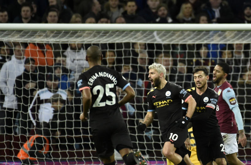 Manchester City's Sergio Aguero, center, celebrates with teammates after scoring his side's third goal during the English Premier League soccer match between Aston Villa and Manchester City at Villa Park in Birmingham, England, Sunday, Jan. 12, 2020. (AP Photo/Rui Vieira)