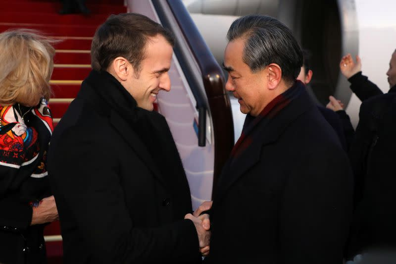 France's Macron expressed concerns about human rights to China's Wang Yi