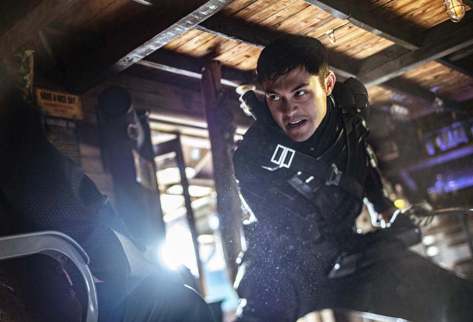"""This image released by Paramount Pictures shows Henry Golding in a scene from """"Snake Eyes: G.I. Joe Origins."""" (Niko Tavernise/Paramount Pictures via AP)"""