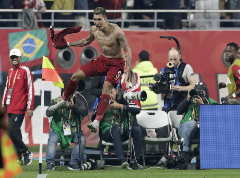 Liverpool's Roberto Firmino celebrates after scoring his sides first goal during the Club World Cup final soccer match between Liverpool and Flamengo at Khalifa International Stadium in Doha, Qatar, Saturday, Dec. 21, 2019. (AP Photo/Hassan Ammar)
