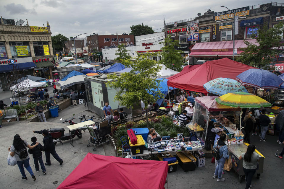 Street vendors in the Corona neighborhood of Queens on June 11, 2021.  (Victor J. Blue/The New York Times)