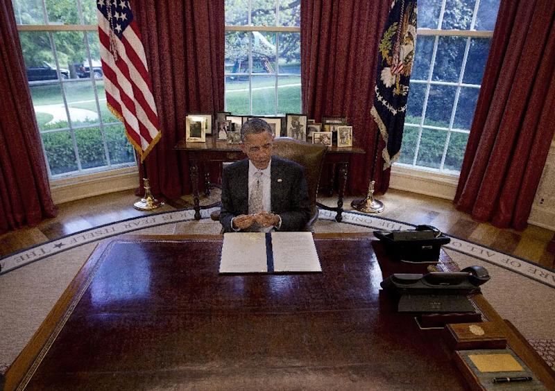 President Barack Obama looks over a proclamation in the Oval Office of the White House in Washington, Friday, April 20, 2012, to designate federal lands within Fort Ord, a former military base located on California's Central Coast, as a National Monument under the Antiquities Act. (AP Photo/Pablo Martinez Monsivais)