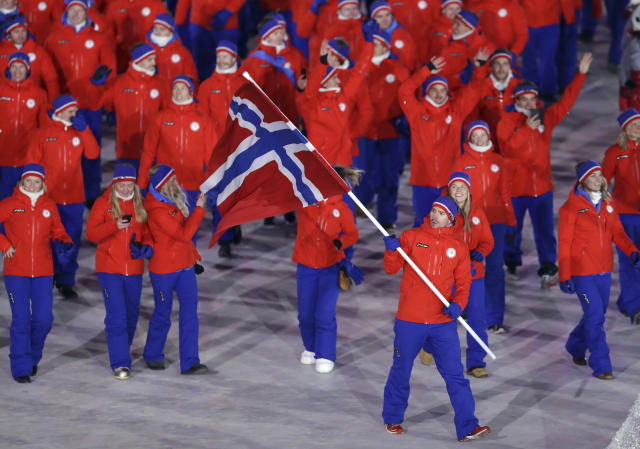 <p>Emil Hegle Svendsen carries the flag of Norway during the opening ceremony of the 2018 Winter Olympics in Pyeongchang, South Korea, Friday, Feb. 9, 2018. (AP Photo/Michael Sohn) </p>