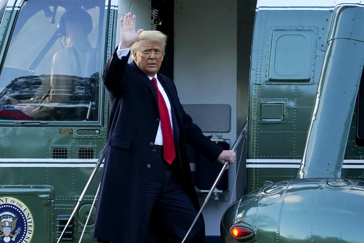 Then-President Donald Trump waves as he boards Marine One on the South Lawn of the White House on Jan. 20. (AP Photo/Alex Brandon)