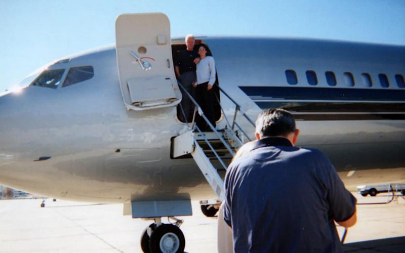 Bill Clinton and Ghislaine Maxwell pose together for the camera as the pair prepare to board Jeffrey Epstein's notorious private jet - The Mega Agency/CDWES