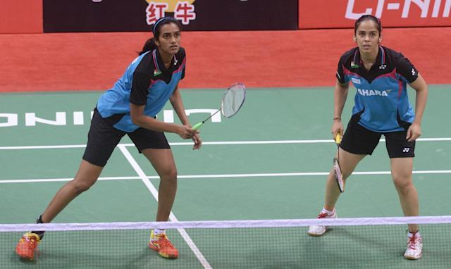 PV Sindhu (L) of India, pictured at Siri Fort Stadium in New Delhi on May 20, 2014 (AFP Photo/Sajjad Hussain)