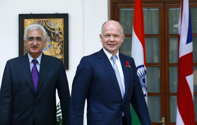 Indian Foreign Minister Salman Khurshid, left, and British Foreign Secretary William Hague arrive for a meeting in New Delhi, India, Thursday, Nov. 8, 2012. Hague is meeting with top officials in the Indian capital to discuss ways to increase trade and investment and to tackle other issues, including terrorism, cyber security and defense. (AP Photo/Saurabh Das)