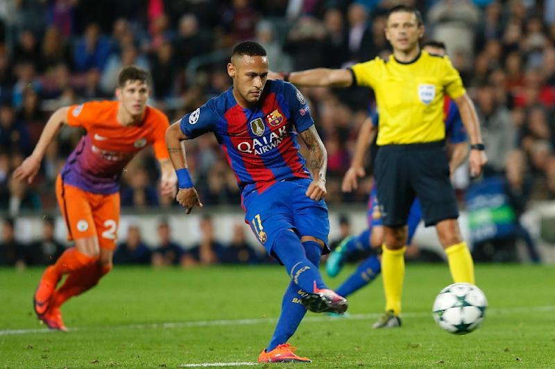 Barcelona's forward Neymar shoots a penalty kick during the UEFA Champions League football match FC Barcelona vs Manchester City at the Camp Nou stadium in Barcelona on October 19, 2016 (AFP Photo/Pau Barrena)