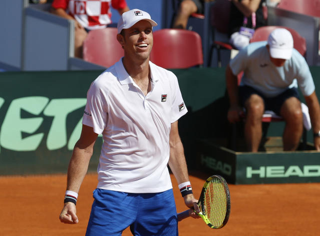 Sam Querrey of the United States celebrates after defeating Marin Cilic of Croatia in their Davis Cup semifinal singles match in Zadar, Croatia, Sunday, Sept. 16, 2018. (AP Photo/Darko Bandic)