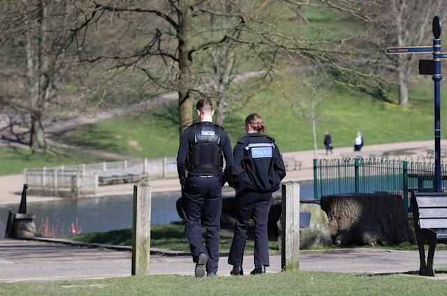 Police officers walk through Mote Park in Maidstone, Kent (Picture: Getty)