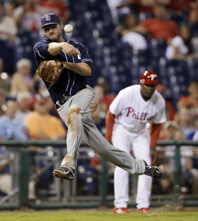 San Diego Padres third baseman Chase Headley throws to first on a single by Philadelphia Phillies' Cameron Rupp during the eighth inning of a baseball game, Tuesday, Sept. 10, 2013, in Philadelphia. San Diego won 8-2. (AP Photo/Matt Slocum)