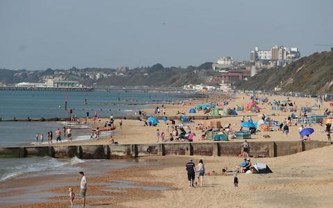 Holidaymakers took to Boscombe Beach in Dorset with their towels and swimming gear - Credit: Andrew Matthews/PA