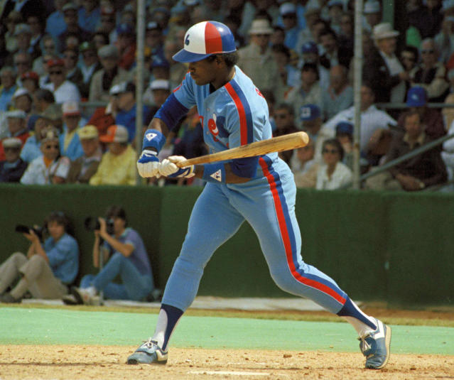 FILE - In this 1983 file photo, Montreal Expos' Tim Raines checks his swing during a baseball game. Raines started wearing the tricolor cap as a teen and proudly sported the Montreal Expos logo for years, all the way onto his Hall of Fame plaque. Now known as the Washington Nationals, the team is set to play in the franchise's first World Series. (AP Photo/File)